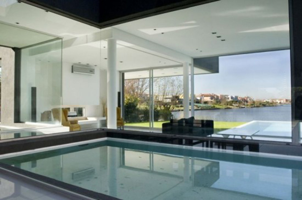 Lavish Black House Design with both Indoor and Outdoor Swimming ...
