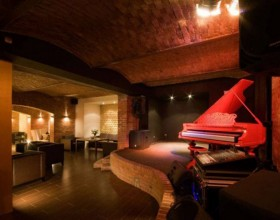 red piano bar decor