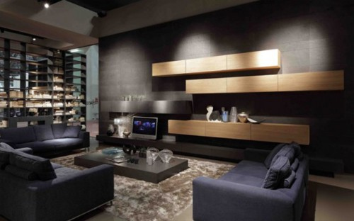 Dark-living-room-with-black-sofas-modern-carpet-modern-illumination-wooden-cabinets-TV-and-modern-coffee-table-spaced-in-the-middle-of-the-room