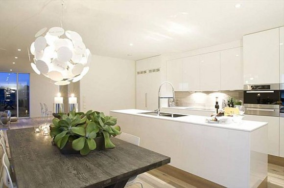 green and clean kitchen space layouts