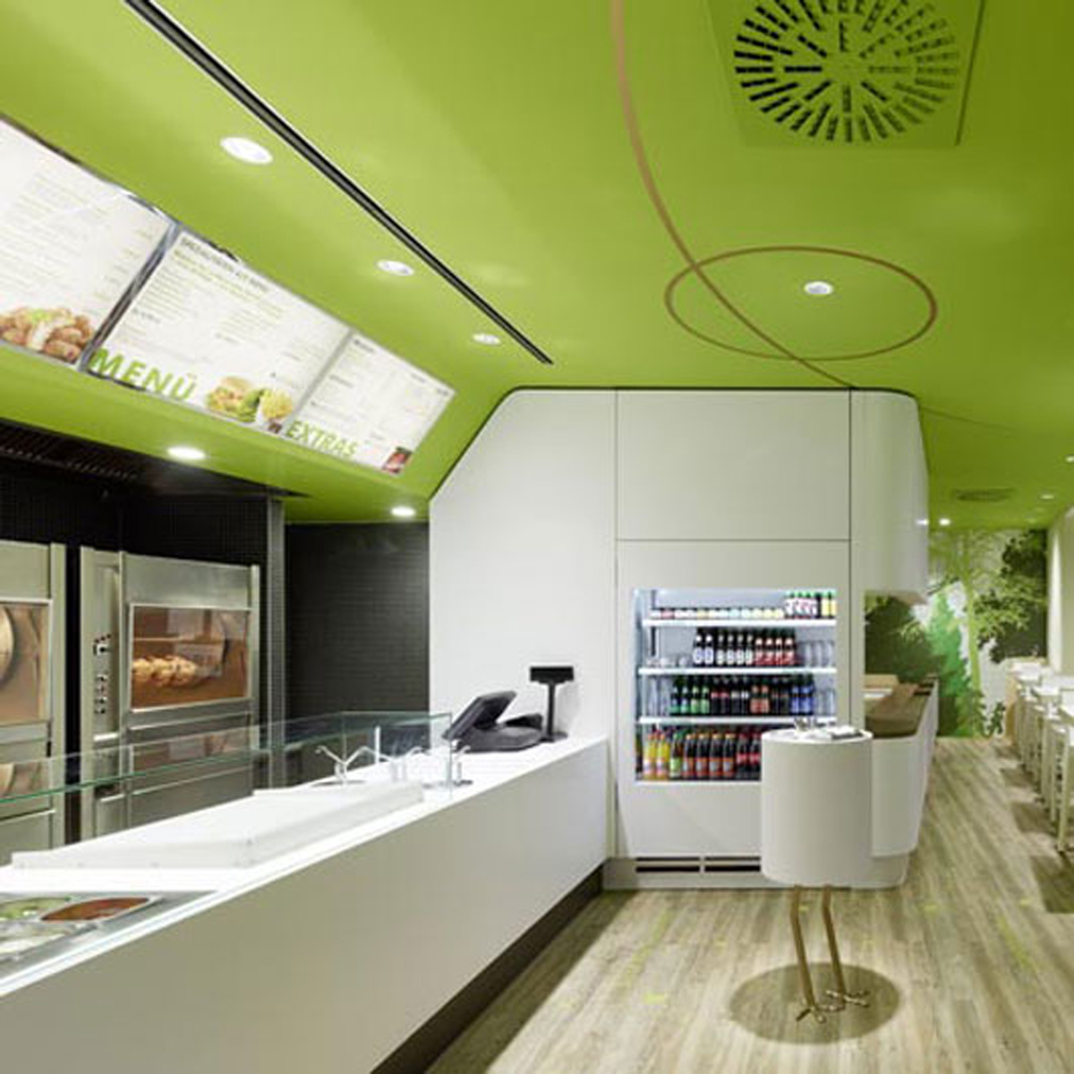 Green and clean restaurant interior for Cuisine on the green