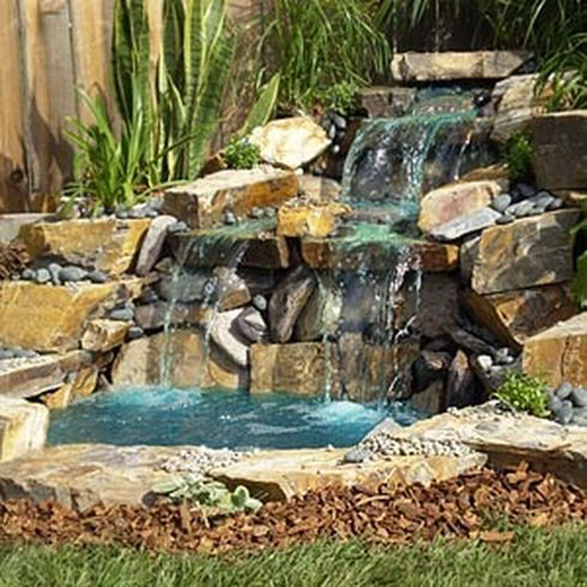 Beautiful house waterfalls design for Garden pond waterfall ideas